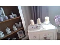 3 glass candle holders with candles