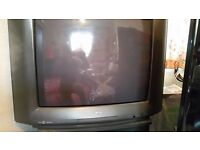 free toshiba tv with stand to good home good working order,approx 28 inch.