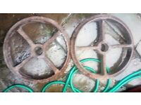 cast iron wheels. vintage agricultural items. have odds & few odd pairs. for garden display