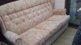 Small settee in soft pink/peach material