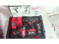 Milwaukee Fuel M18 CHIWP12 1/2 Impact Wrench and M12 CIW38 Brushless Impact 2x5.0Ah Batteries.