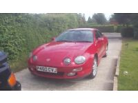 Loved red celica for sale.