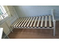 Single white metal bed with sprung support(nearly New) in immaculate condition