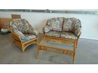 Cane 2 seater and armchair. Coffee table. Will deliver £85