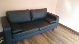 Black two seater faux leather sofa