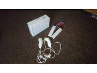 Nintendo Wii + balance board + games + controllers