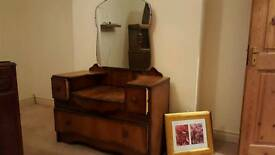Wooden dresser with mirror and drawers