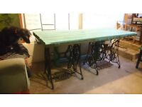 Large table with vintage sewing machine iron legs and bench