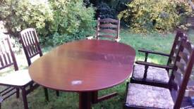 Mahogany look dining table with 5 chairs fold away style