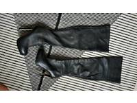 Knee high, top shop real leather boots in size 6.