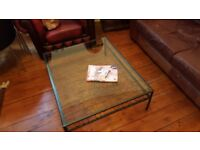 Coffee Table with a metal frame and glass top.