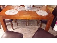 Dark wood Dinning table with 6 brown leather high back chairs
