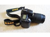 Nikon D90 DSLR camera with Nikon 18-105mm lens, excellent condition, with accessories