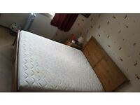 Ikea king size bed. Wood frame. Extra thick excellent quality ikea hamnik foam mattess