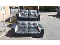 2 2 seater sofas in black & white leather with chrome feet, was £2500 new we need £275!