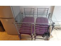 Glass Top Metal Table and 4 Chairs