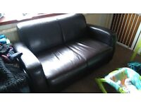 Very clean dark brown leather (faux) sofa for sale.