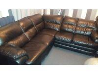 black leather corner sofa in used condition