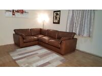 Ex-display Alexander and James Madison brown leather corner sofa