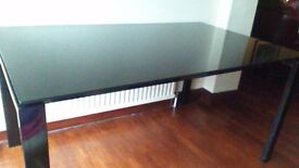 Black glass top table in perfect condition
