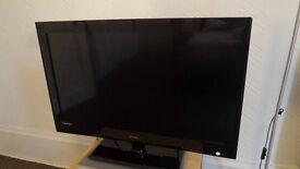 Technika 32 inch flatscreen 1080 HD TV with built-in Freeview.