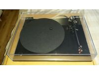 A Rega RP3 boxed in very good condition.