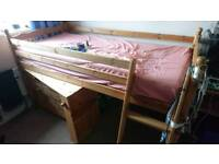 Childrens cabin bed with built in pull out desk and chest of drawers