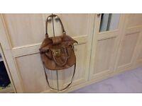 Brown Handbag, 2 Handles, Butterfly Button, Zips, Good condition, Contact me soon as, Cheap price £2