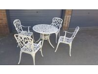 Cast alloy bistro table and 4 chairs