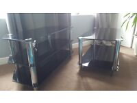 Black glass matching coffee table & tv unit. Good condition with only a few marks/scratches.