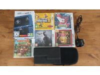 New Nintendo 3DS XL Metallic Blue + 5 games + 2 Cases + Charging Cable