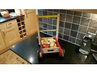 Premium Wooden baby walker with blocks.