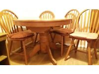 "Dining room table and 4 chairs 36"" diameter expands to 5"". Good condition"