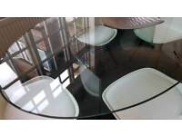 Stunning oval glass dining table with double curved base