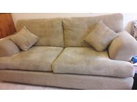 One large 3 seater sofa with matching armchair and 2 small cushions. In very good condition.