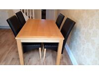 Dining table and four chairs - collection only