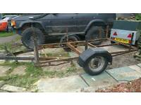 Trailer frame with wheels and wheel arches
