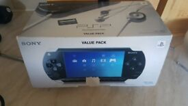 sony psp and 5 games 60ono