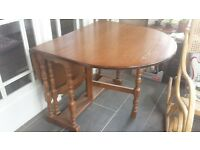 large dining table with fold down sides