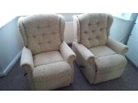 Two Manual Fabric Reclining Armchairs .