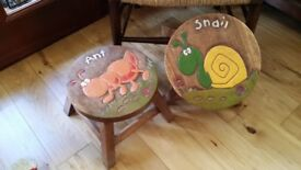 2 carved solid wood stools