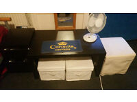Table, two boxes in tissue, fan, white puff, desk, chair and nigth table