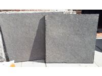 Black slate patio slabs various sizes can be used for a patio or drive way can be seen laid