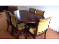 Dining table with extending leaves and six chairs. Matches dresser.