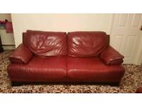 Real Red leather DFS sofa.