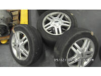 4X FORD ALLOYS WITH TYRES - 15 INCH