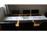 Solid oak dining table with 6 faux leather brown chairs. Looking for £70 , L 162cm W92cm H 76.5cm.