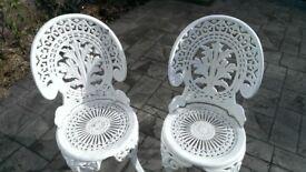 Four White Cast Aluminium Garden Chairs