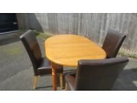 Pine table and 3 dining chairs
