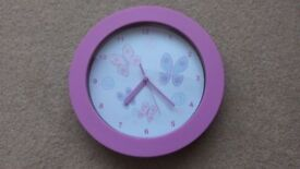 Gorgeous pink clock with butterfly design.